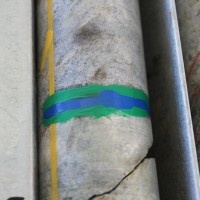 Paint markers are used to identify zones of particular interest in diamond-drilled core from the Nolans Bore rare-earth deposit, Northern Territory, Australia.