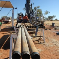 Drill pipe that will be used in the diamond drilling rig in the background, at the Nolans Project, Northern Territory, Australia.